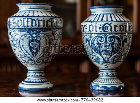 Two old italian ceramic pharmacy jars hand painted. The word 'sulfuriche' on the first one means sulfuric, the word 'cicoria' on the secon one means chicory. #776439682