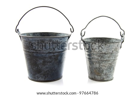 Two old metal vintage buckets isolated over white