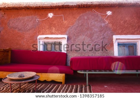 Two old red couches on a terrace in Tamellalt in Dades Gorges, Atlas Mountains, Morocco #1398357185