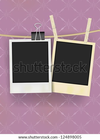 Two Old Retro Blank Photo Frames Hanging on Rope - on Vintage Wallpaper
