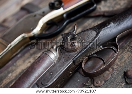 Two old rifles sit on a table