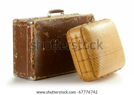 Two old travel suitcases isolated on white