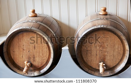 Two old wooden barrels with wine