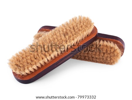 Two old wooden brushes for cleaning clothes isolated on white background