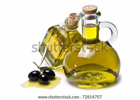 Two olive oil pourers and some olives isolated on a white background.