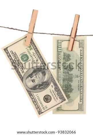 Two one hundred dollar bills is hanging on a rope with wooden clothespin isolated on white