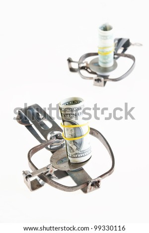 Two open traps with a bundle of dollars