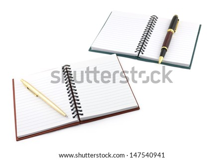 two opened notebooks with pens isolated on white