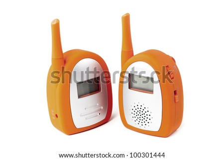 Two orange baby monitors standing side by side