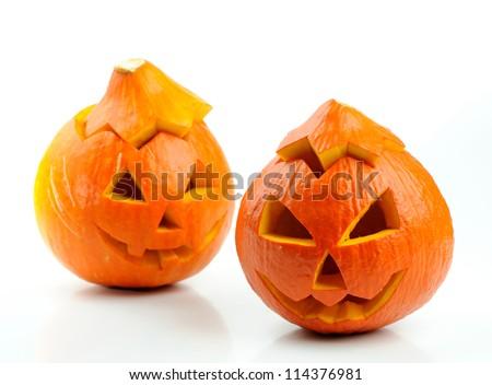 Two orange halloween pumpkins Jack O Lanterns isolated on white background