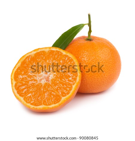Two orange mandarins with green leaf isolated on white background