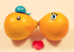 two oranges kissing isolated.  Love and tenderness. sign, symbol, concept of couple