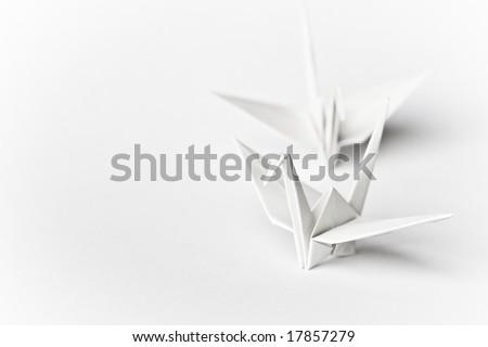 Two origami birds on a white background - stock photo