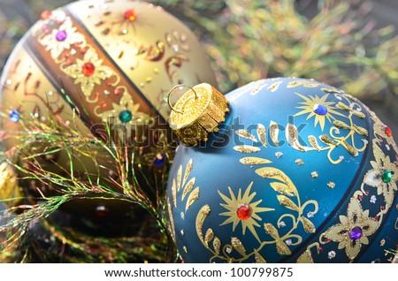 Two ornamental Christmas ornaments with eyelash ribbon.