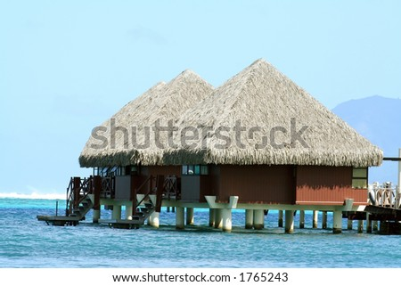 two overwater bungalows in Tahiti, French Polynesia - stock photo