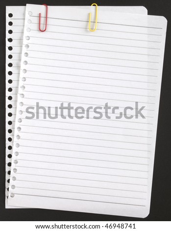 two pages with paper clips on a black background