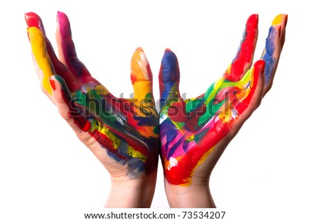 two painted colorful hands form a cup in front of white background