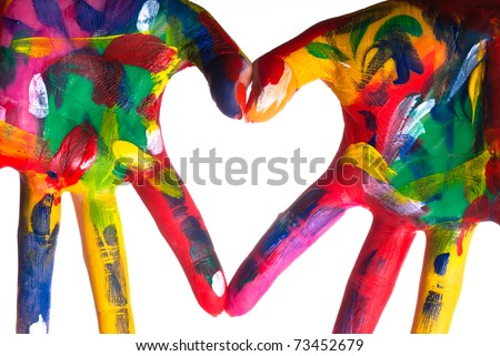 two painted colorful hands forming a heart on a white background