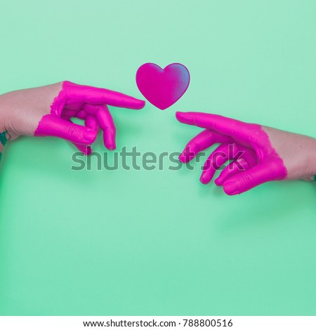 Two painted hands touch the heart by fingers.  Contemporary art collage.
