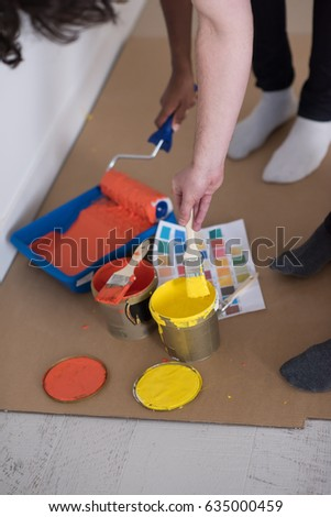two painters prepare color for painting the wall #635000459