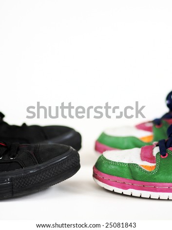 two pair of contrasting sneakers facing each other
