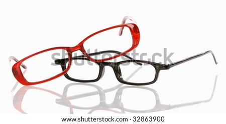 two pair of eye glasses with reflection on white background - stock photo