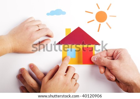 two pair of hand with color paper application of house