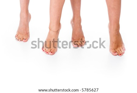 Two pairs female legs on a floor