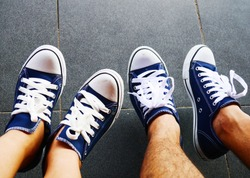 Two pairs of blue shoes of wedding couples