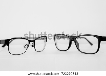 Two Pairs of Glasses - Black and White  #723292813