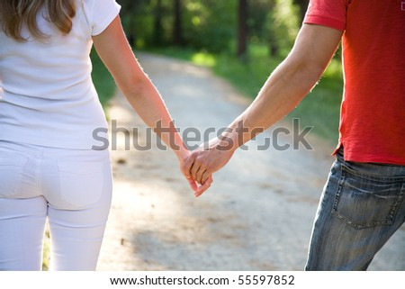 two pairs of hands in love tenderly hold together