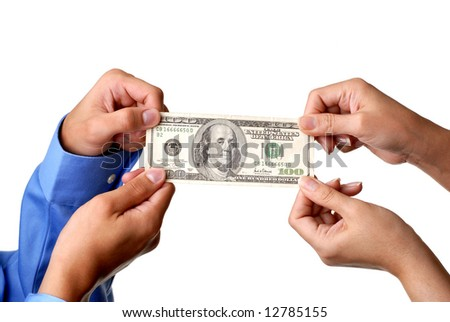 Two pairs of hands pulling US currency