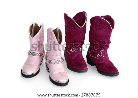 Two pairs of pink cowgirl boots on white background.