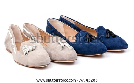 Two pairs of women suede shoes over white background