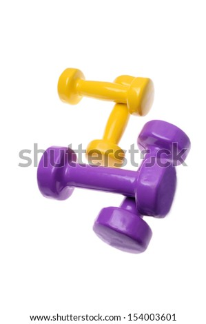 Two Pairs of yellow and purple dumbbells Isolated on white background