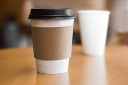 Two paper coffee cups