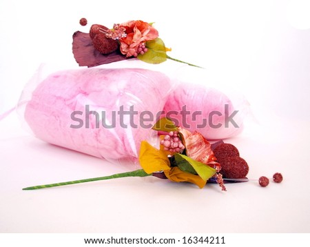 two Paper flower art used in wedding ceremonies as gift lay horizontal with packed candy floss