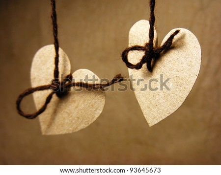 Two paper hearts on wire with nodules. Love concept.