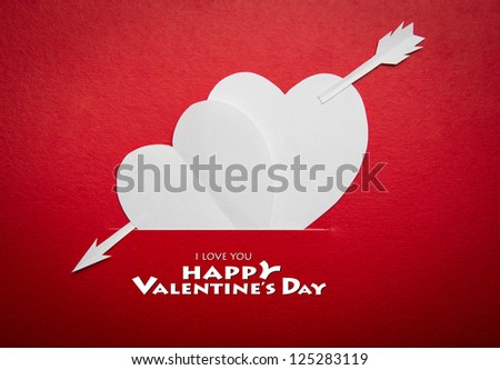 Two paper hearts pierced with an arrow symbol for Valentines day  with copy space for text or design