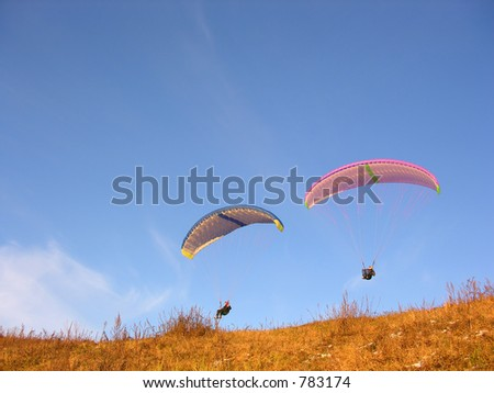 two paraglider