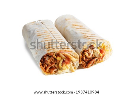 Two parts of Eastern cheesy shawarma with layers of chicken meat, cucumber, cabbage, cheese served on plate, isolated on white background. Turkish donner wrapped in lavash bread.  Stock photo ©