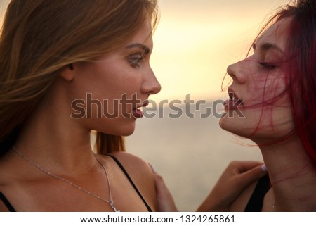 Two passionate girls portrait photo.Focus on lips #1324265861