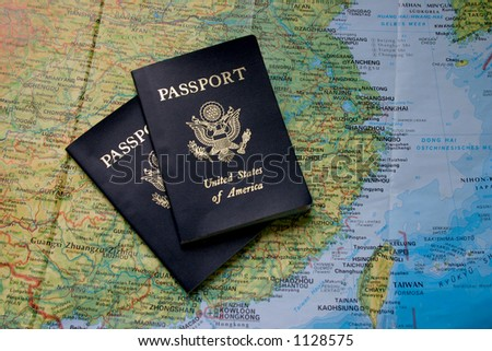 Two passports on top of a map of Asia