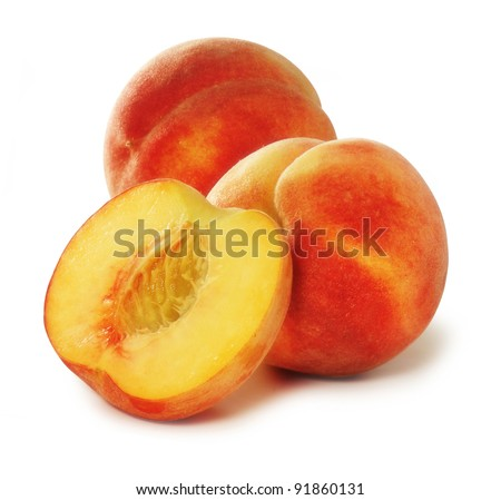 two peaches and a half isolated - stock photo
