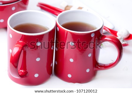 Two Peas in a red cup on a white background