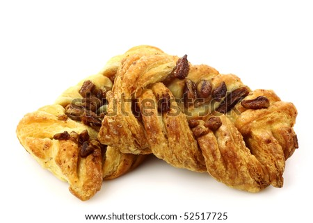 two pecan sticky buns on a white background