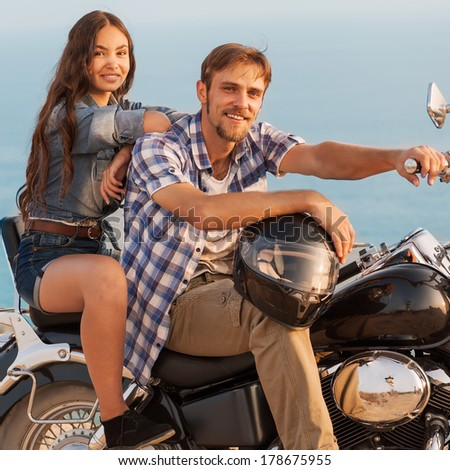 Two people and bike - fashion woman and man. Adventure and vacations concept