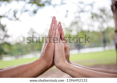 Two People High Five with Both Two Hands in the Air to Greeting Power of Tag-Team. Close friend Joy Working Togetherness. Volunteer Collaboration in Project Team success.Teamwork Together Concept.