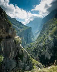 Two people hiking the cares trail in Picos de Europa national park Asturias, Spain