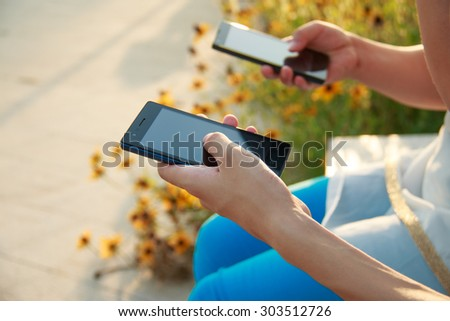Two people holding smart mobile Internet #303512726